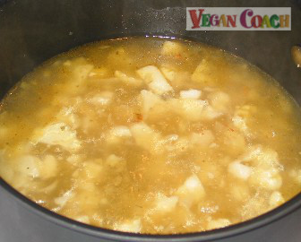 Add veggie broth and cover until cauliflower is tender
