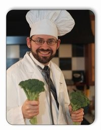 Dr. Greger in chef's hat holding broccoli