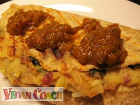 Vegan Panini made with Swiss chard and potatoes and topped with salsa