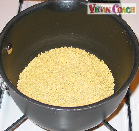 Millet toasting in a small pot