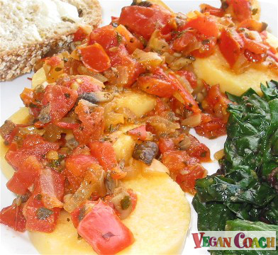 Tomato Ragout served over polenta slices with a side of cooked kale