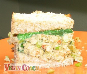 Sandwich spread between two thick pieces of whole grain bread