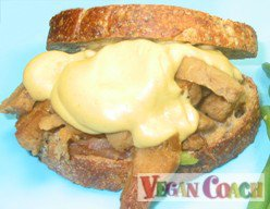Seitan sandwich with a creamy cheesy sauce