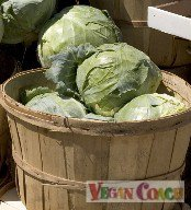 Heads of green cabbage in a large basket