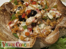 Tortilla bowls filled with tempeh, peppers, and olives and drizzled with homemade sour cream